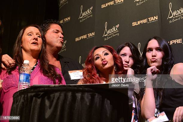 V Personality Nicole 'Snooki' Polizzi poses with fans during the Nicole 'Snooki' Polizzi Meet Greet during the 2013 Smart Tan Downtown Convention at...