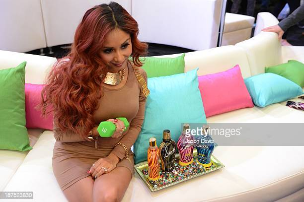 V Personality Nicole 'Snooki' Polizzi poses with products during the Nicole 'Snooki' Polizzi Meet Greet during the 2013 Smart Tan Downtown Convention...