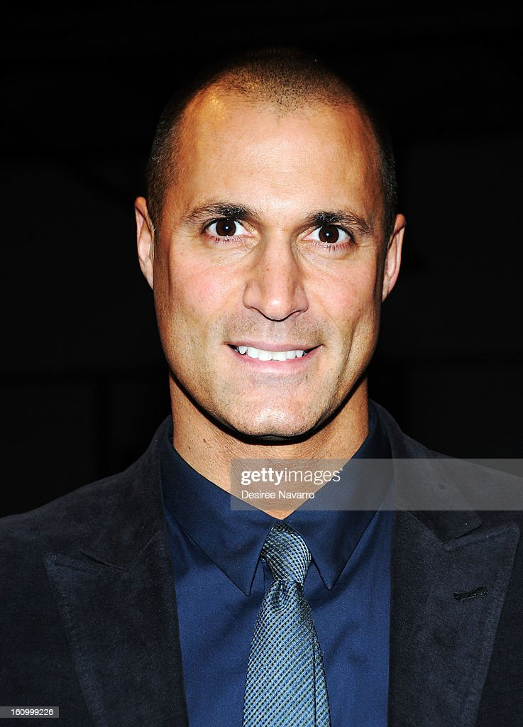 TV Personality <a gi-track='captionPersonalityLinkClicked' href=/galleries/search?phrase=Nigel+Barker&family=editorial&specificpeople=691819 ng-click='$event.stopPropagation()'>Nigel Barker</a> attends Yigal Azrouel during Fall 2013 Mercedes-Benz Fashion Week at Highline Stages on February 8, 2013 in New York City.