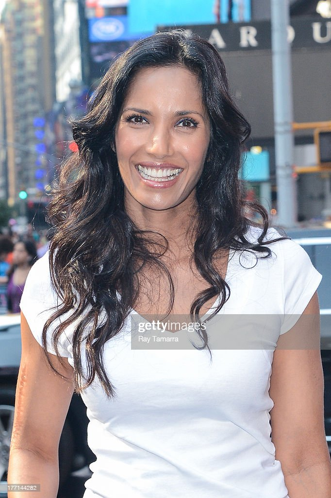 TV personality <a gi-track='captionPersonalityLinkClicked' href=/galleries/search?phrase=Padma+Lakshmi&family=editorial&specificpeople=201593 ng-click='$event.stopPropagation()'>Padma Lakshmi</a> walks in Times Square on August 21, 2013 in New York City.