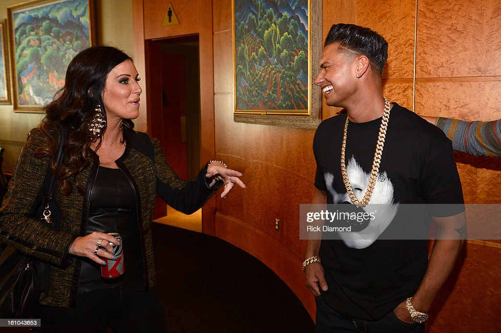TV personality Patti Stanger and DJ Paul 'Pauly D' DelVecchio pose backstage at the GRAMMYs Dial Global Radio Remotes during The 55th Annual GRAMMY Awards at the STAPLES Center on February 8, 2013 in Los Angeles, California.