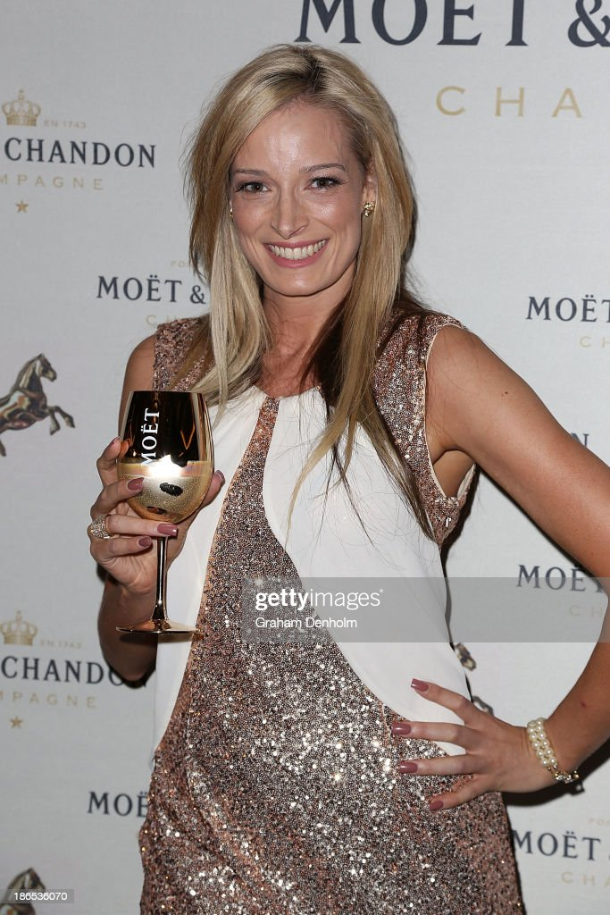 TV personality Penny Palman from 'The Bachelor' poses at the Moet & Chandon Derby Eve party held at The Waiting Room, Crown Towers on November 1, 2013 in Melbourne, Australia.