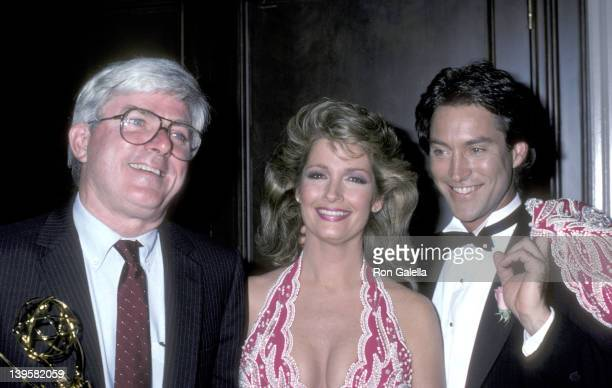 TV personality Phil Donahue actress Deidre Hall and actor Drake Hogestyn attend the 13th Annual Daytime Emmy Awards on July 17 1986 at The...