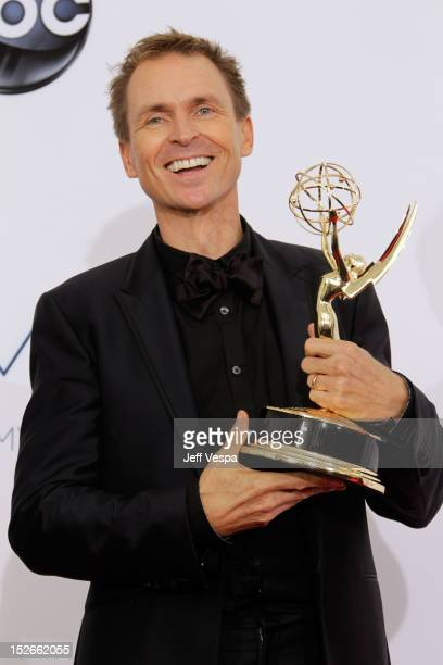 TV personality Phil Keoghan poses in the press room during the 64th Primetime Emmy Awards at Nokia Theatre LA Live on September 23 2012 in Los...