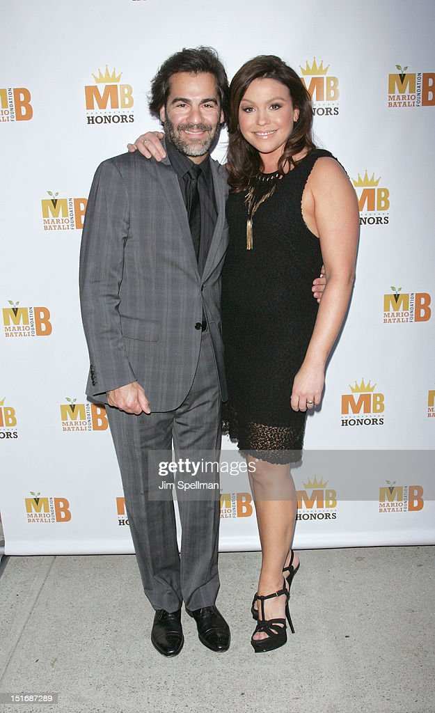 TV Personality <a gi-track='captionPersonalityLinkClicked' href=/galleries/search?phrase=Rachael+Ray&family=editorial&specificpeople=542712 ng-click='$event.stopPropagation()'>Rachael Ray</a> (R) and husband <a gi-track='captionPersonalityLinkClicked' href=/galleries/search?phrase=John+Cusimano&family=editorial&specificpeople=542713 ng-click='$event.stopPropagation()'>John Cusimano</a> attend the 2012 Mario Batali Foundation Honors Dinner at Del Posto Ristorante on September 9, 2012 in New York City.
