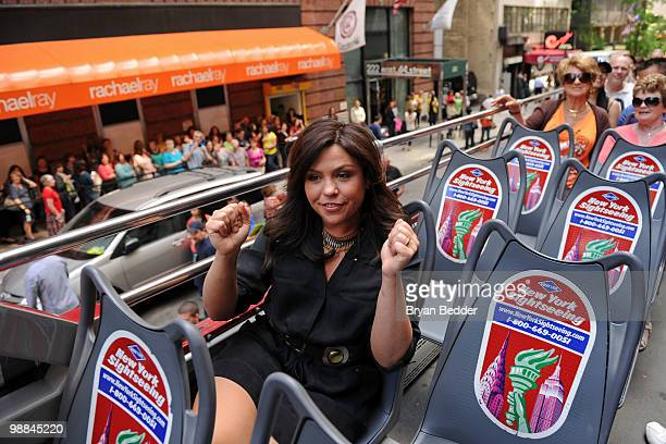 TV personality Rachael Ray rides on a bus while being honored as Grey Line New York's 'Ride of Fame' personality at the Rachael Ray Studios on May 4...