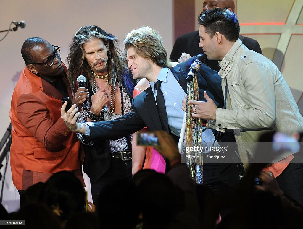 TV personality Randy Jackson, musician Steven Tyler, actor Keegan Allen and musician David Osmond perform onstage during the 21st annual Race to Erase MS at the Hyatt Regency Century Plaza on May 2, 2014 in Century City, California.