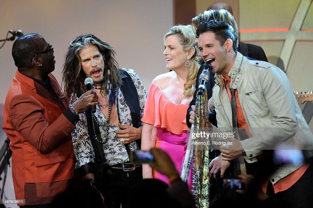 TV personality Randy Jackson, musician Steven Tyler, host Nancy Davis, and musician David Osmond perform onstage during the 21st annual Race to Erase MS at the Hyatt Regency Century Plaza on May 2, 2014 in Century City, California.