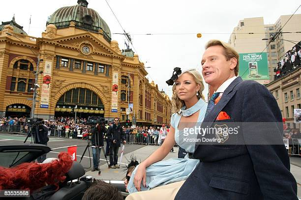 TV personality Rebecca Madden and US TV personality Carson Kressley ride together during the Emirates Melbourne Cup Parade on Swanston Street on...