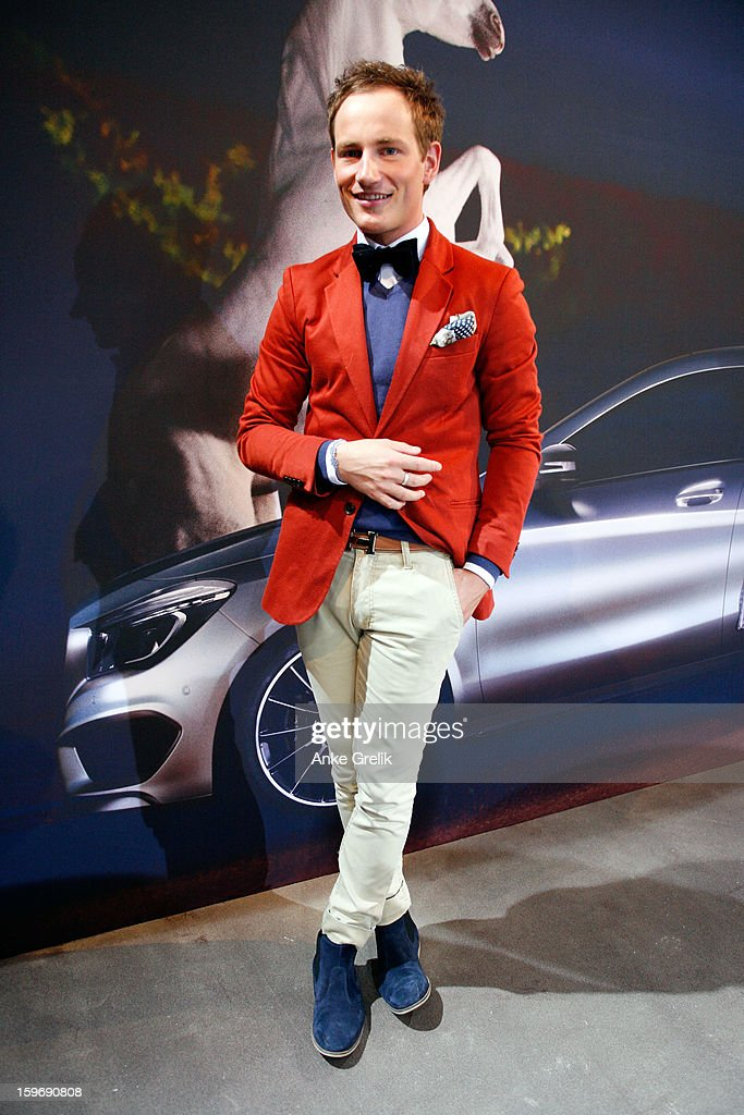 TV personality Ricky Breitengraser wearing Thomas Rath jacket, trouser and sweater attends Mercedes-Benz Fashion Week Autumn/Winter 2013/14 at the Brandenburg Gate on January 18, 2013 in Berlin, Germany.
