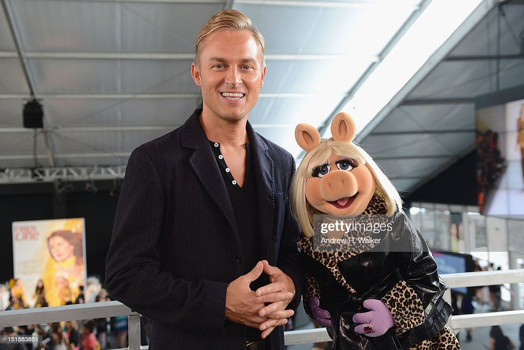 TV personality <a gi-track='captionPersonalityLinkClicked' href=/galleries/search?phrase=Robbie+Laughlin&family=editorial&specificpeople=228095 ng-click='$event.stopPropagation()'>Robbie Laughlin</a> and Miss Piggy attend Spring 2013 Mercedes-Benz Fashion Week at Lincoln Center for the Performing Arts on September 8, 2012 in New York City.