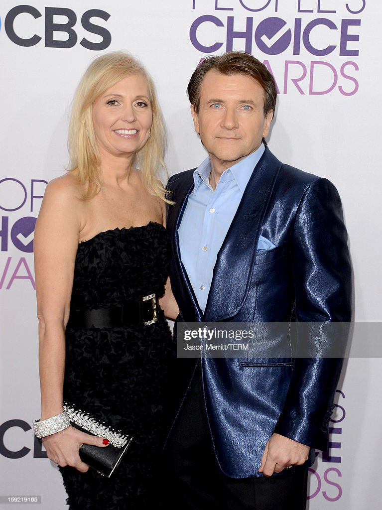 TV personality <a gi-track='captionPersonalityLinkClicked' href=/galleries/search?phrase=Robert+Herjavec&family=editorial&specificpeople=6129084 ng-click='$event.stopPropagation()'>Robert Herjavec</a> (R) and Diane Plese attend the 39th Annual People's Choice Awards at Nokia Theatre L.A. Live on January 9, 2013 in Los Angeles, California.