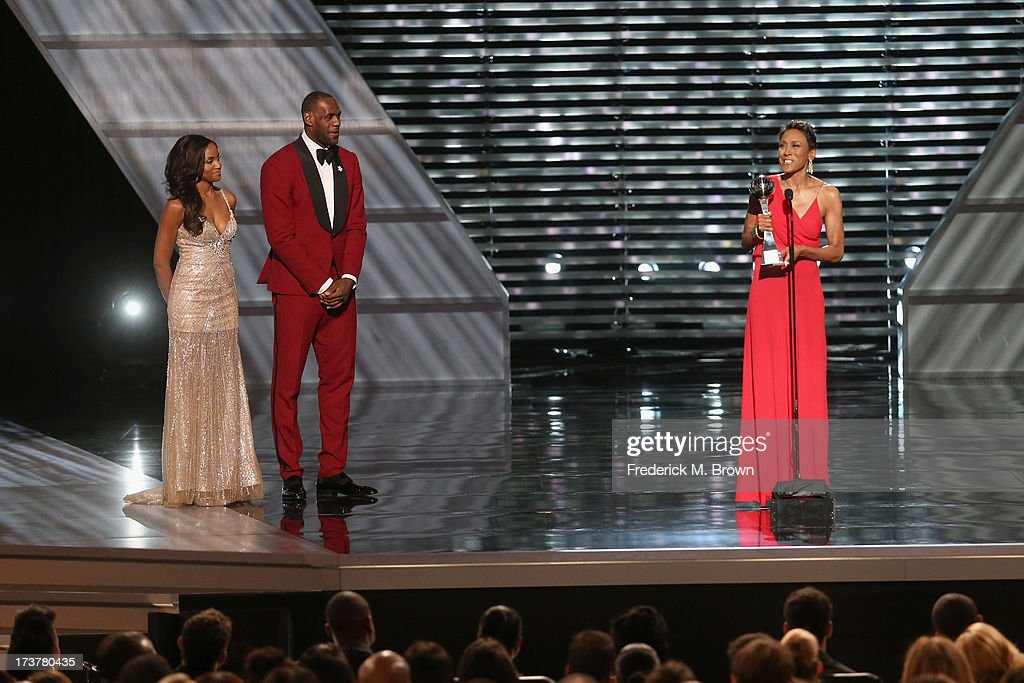 TV personality Robin Roberts and NBA player onstage after being presented the Arthur Ashe Courage Award at The 2013 ESPY Awards at Nokia Theatre L.A. Live on July 17, 2013 in Los Angeles, California.