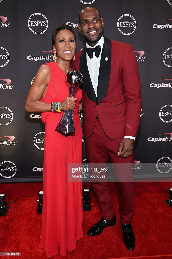 TV personality Robin Roberts, recipient of the Arthur Ashe Courage Award, and NBA player LeBron James pose backstage at The 2013 ESPY Awards at Nokia Theatre L.A. Live on July 17, 2013 in Los Angeles, California.