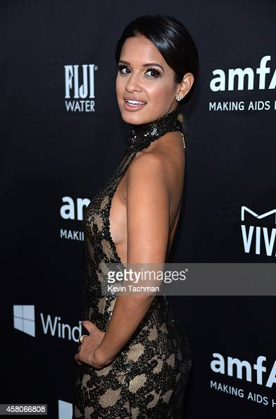 TV personality Rocsi Diaz attends amfAR LA Inspiration Gala honoring Tom Ford at Milk Studios on October 29 2014 in Hollywood California