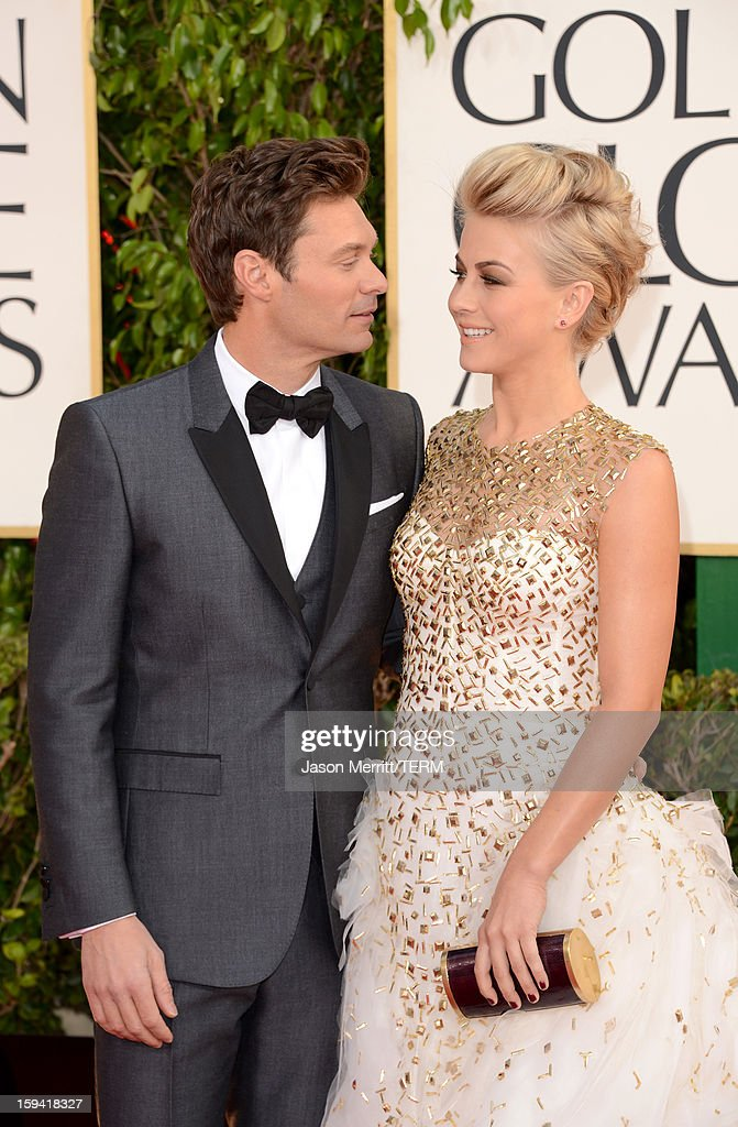 TV personality Ryan Seacrest (L) and actress Julianne Hough arrive at the 70th Annual Golden Globe Awards held at The Beverly Hilton Hotel on January 13, 2013 in Beverly Hills, California.