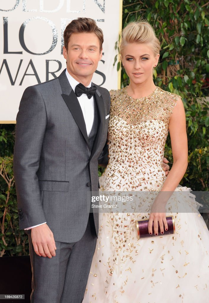 TV personality Ryan Seacrest and actress Julianne Hough arrive at the 70th Annual Golden Globe Awards held at The Beverly Hilton Hotel on January 13, 2013 in Beverly Hills, California.