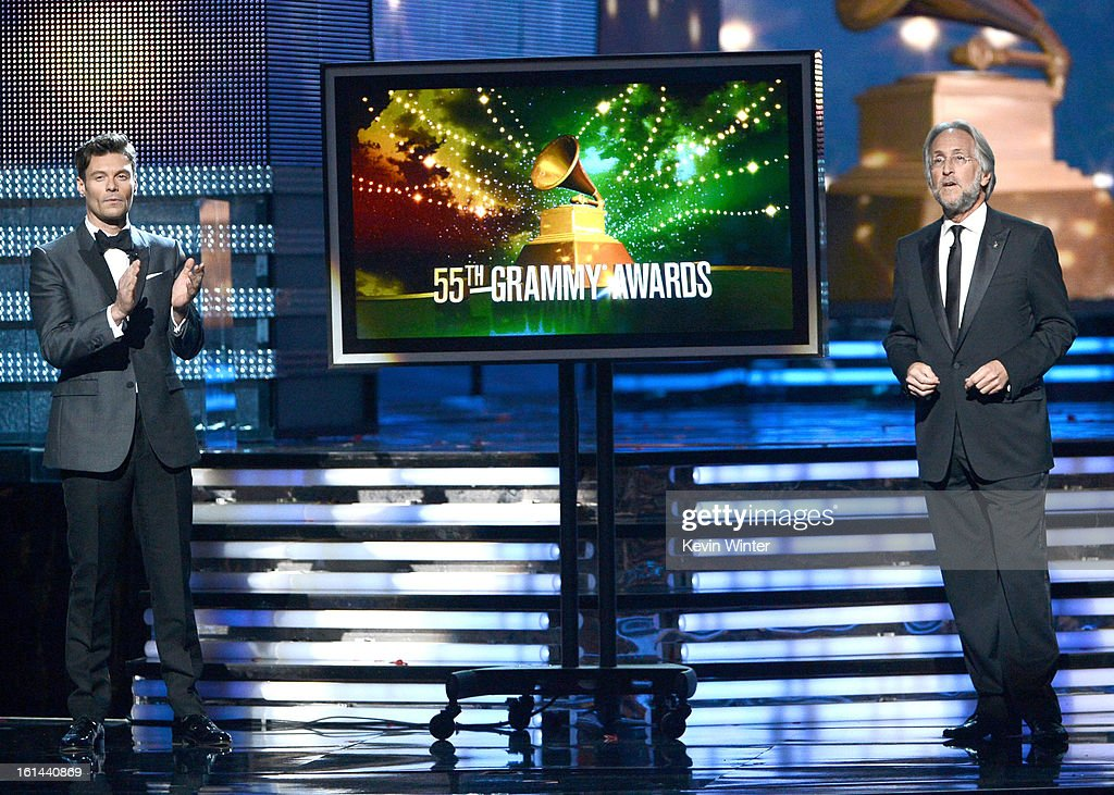 TV personality Ryan Seacrest (L) and President/CEO of The Recording Academy Neil Portnow speak onstage during the 55th Annual GRAMMY Awards at STAPLES Center on February 10, 2013 in Los Angeles, California.
