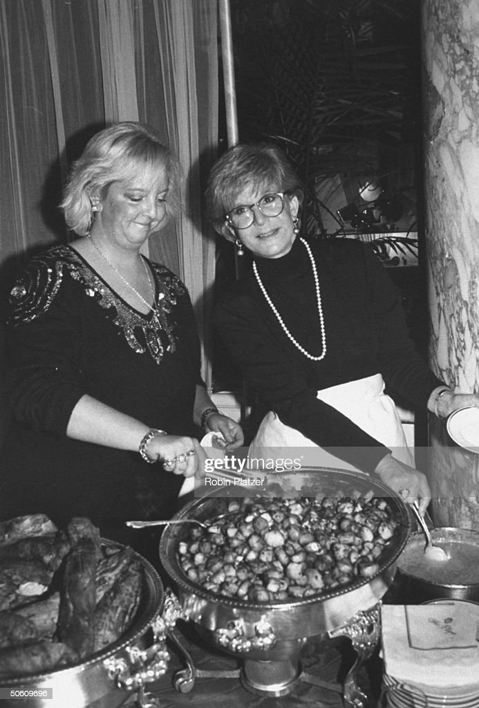 TV personality Sally Jessy Raphael and her daughter Allison Vladimir setting up food they prepared for a March of Dimes benefit at the Plaza Hotel.