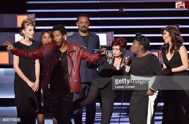 TV personality Sharon Osbourne kicks a stage crasher while Osbourne and fellow 'The Talk' hosts Sheryl Underwood and Julie Chen accept the award for...