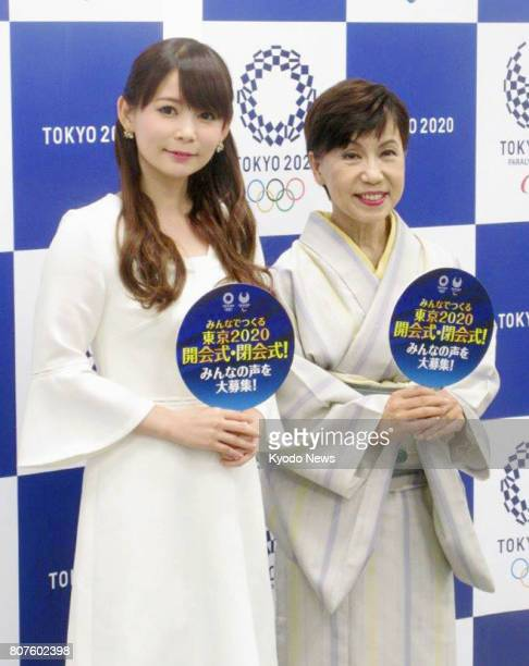 TV personality Shoko Nakagawa and Yuko Tanaka president of Tokyo's Hosei University pose for photos after they took part in an interview session in...