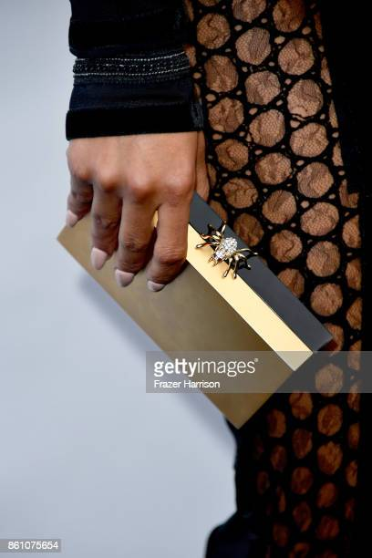 TV personality Sibley Scoles clutch detail attends the amfAR Gala at Ron Burkle's Green Acres Estate on October 13 2017 in Beverly Hills California