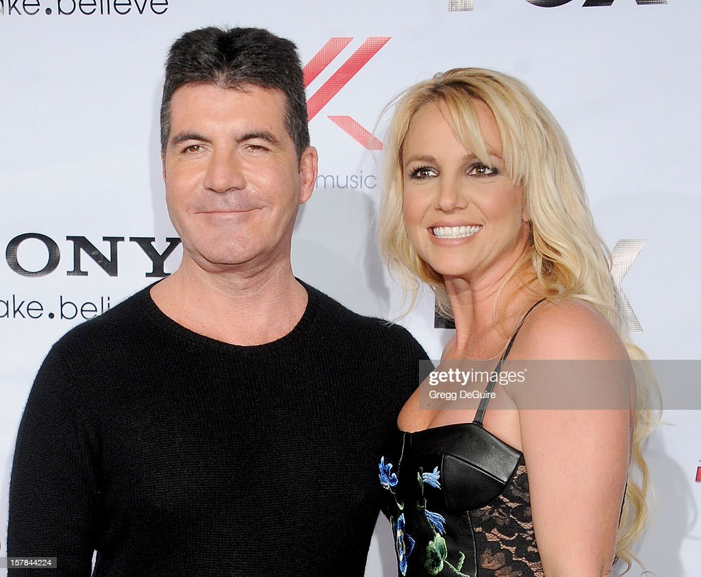 TV personality <a gi-track='captionPersonalityLinkClicked' href=/galleries/search?phrase=Simon+Cowell&family=editorial&specificpeople=203007 ng-click='$event.stopPropagation()'>Simon Cowell</a> and singer <a gi-track='captionPersonalityLinkClicked' href=/galleries/search?phrase=Britney+Spears&family=editorial&specificpeople=156415 ng-click='$event.stopPropagation()'>Britney Spears</a> arrive at FOX's 'The X Factor' viewing party at Mixology101 & Planet Dailies on December 6, 2012 in Los Angeles, California.