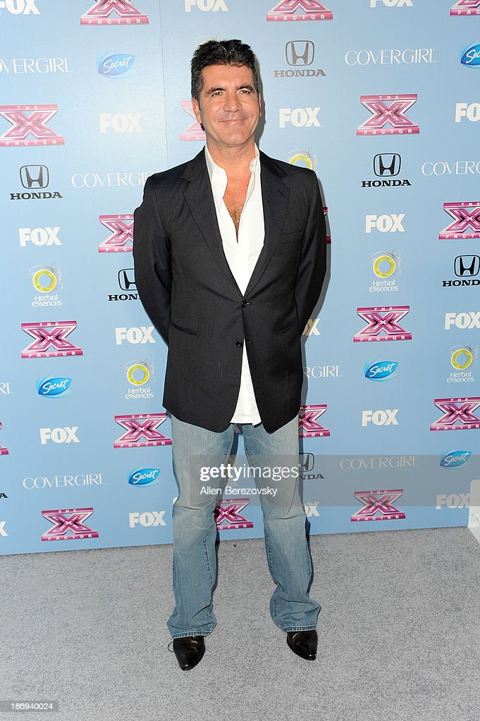 TV personality <a gi-track='captionPersonalityLinkClicked' href=/galleries/search?phrase=Simon+Cowell&family=editorial&specificpeople=203007 ng-click='$event.stopPropagation()'>Simon Cowell</a> arrives at 'The X Factor' Finalists Party at SLS Hotel on November 4, 2013 in Los Angeles, California.