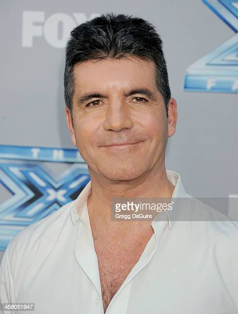 TV personality Simon Cowell attends FOX's 'The X Factor' season finale at CBS Television City on December 19 2013 in Los Angeles California