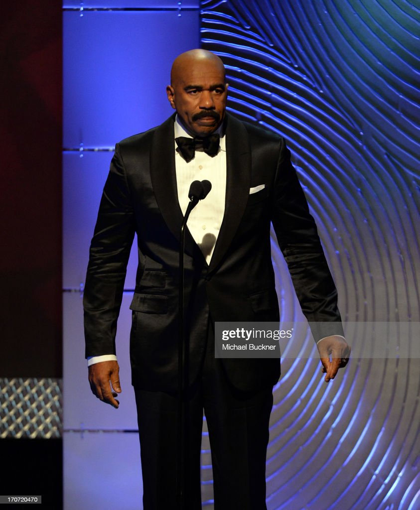 TV personality <a gi-track='captionPersonalityLinkClicked' href=/galleries/search?phrase=Steve+Harvey&family=editorial&specificpeople=210865 ng-click='$event.stopPropagation()'>Steve Harvey</a> onstage during the 40th Annual Daytime Emmy Awards at the Beverly Hilton Hotel on June 16, 2013 in Beverly Hills, California. 23774_001_2486.JPG
