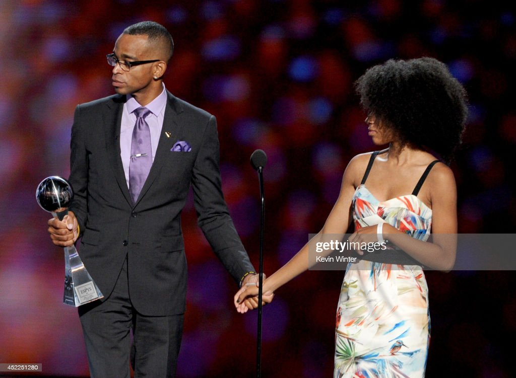 TV personality Stuart Scott accepts the Jimmy V Perseverance Award with his daughter onstage during the 2014 ESPYS at Nokia Theatre L.A. Live on July 16, 2014 in Los Angeles, California.