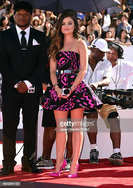 TV personality Sway Calloway and actress Lucy Hale attend the 2014 MTV Video Music Awards at The Forum on August 24 2014 in Inglewood California