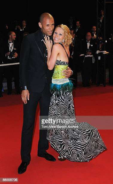 TV personality Tatiana Laurens and husband Xavier Delarue attend the 'Vincere' premiere at the Grand Theatre Lumiere during the 62nd Annual Cannes...