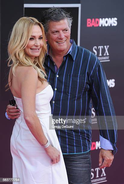 TV personality Taylor Armstrong and husband John Bluher arrive at the premiere of STX Entertainment's 'Bad Moms' at Mann Village Theatre on July 26...