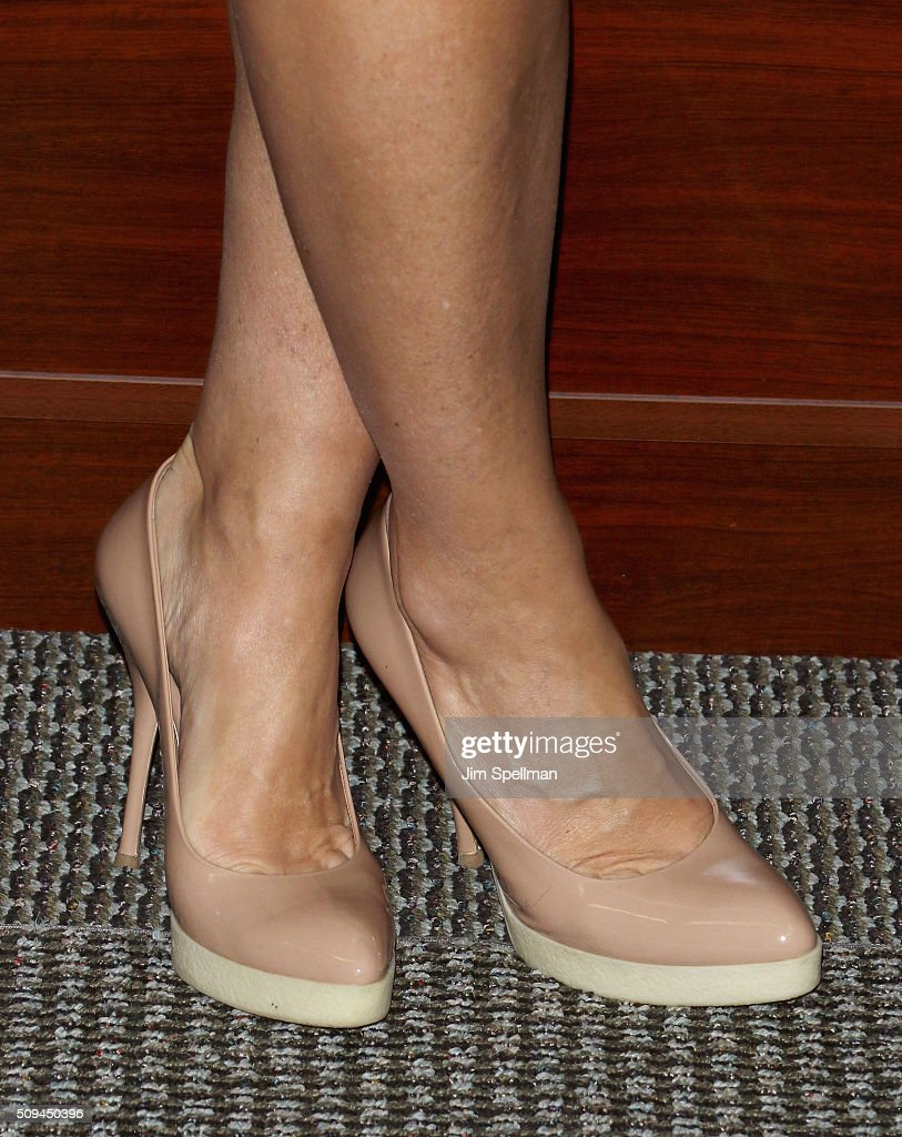 TV personality Teresa Giudice shoe detail signs copies of 'Turning The Tables' at Bookends on February 10 2016 in Ridgewood New Jersey