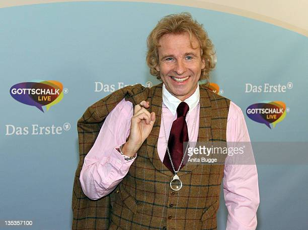 TV personality Thomas Gottschalk poses for the press prior to a press conference for his new TV show 'Gottschalk Life' on December 9 2011 in Berlin...