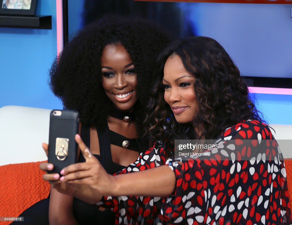 TV personality Tia Shipman (L) and actress/host Garcelle Beauvais attend Hollywood Today Live at W Hollywood on July 1, 2016 in Hollywood, California.