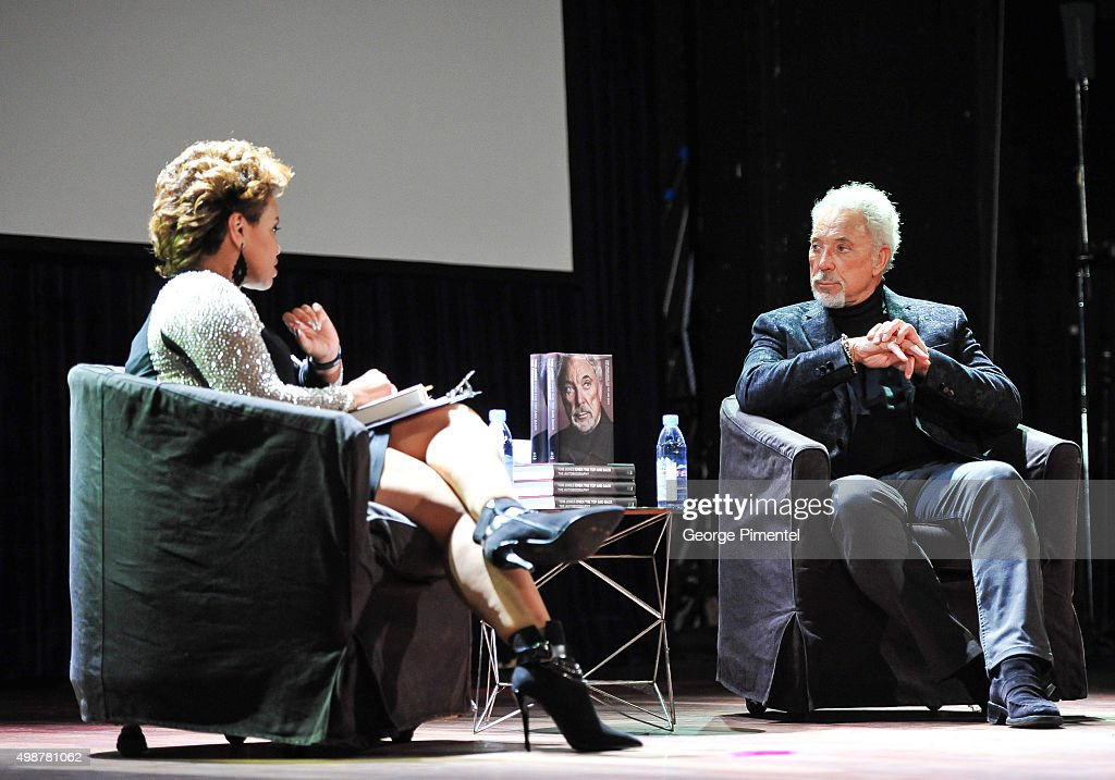 TV personality Traci Melchor and Sir Tom Jones attend his promoting of his new book 'Over The Top And Back: The Autobiography' at The Opera House on November 25, 2015 in Toronto, Canada.
