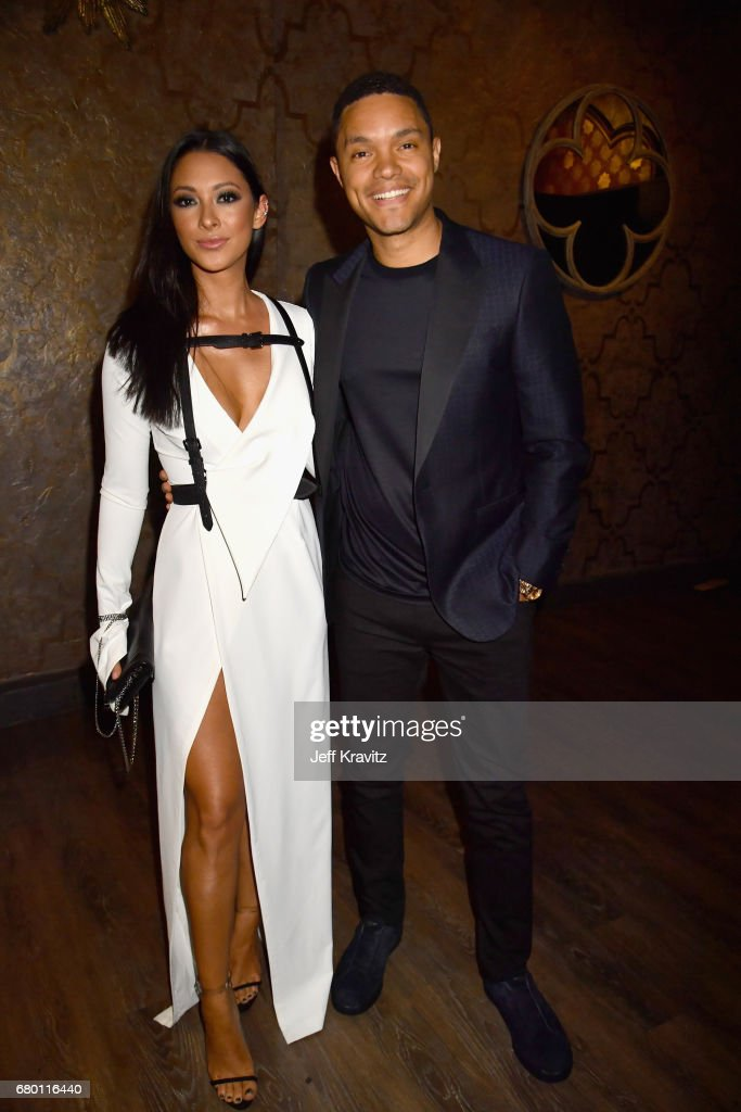 TV personality Trevor Noah (R) and Jordyn Taylor attend the 2017 MTV Movie And TV Awards at The Shrine Auditorium on May 7, 2017 in Los Angeles, California.