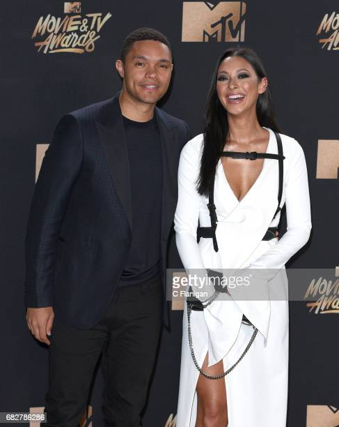 TV personality Trevor Noah and singer Jordyn Taylor attend the 2017 MTV Movie And TV Awards at The Shrine Auditorium on May 7 2017 in Los Angeles...