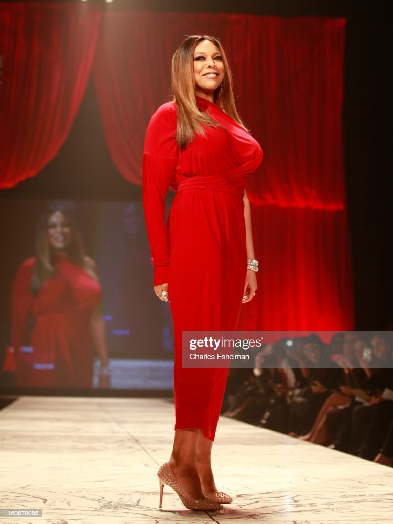 TV personality Wendy Williams walks runway at The Heart Truth's Red Dress Collection Fall 2013 Mercedes-Benz Fashion Show at 499 Seventh Avenue on February 6, 2013 in New York City.