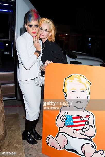 Personality/pop artist Sham Ibrahim and singer Katy Perry pose for a photo with a Donald Trump portrait at Oscar's on January 14 2017 in Palm Springs...