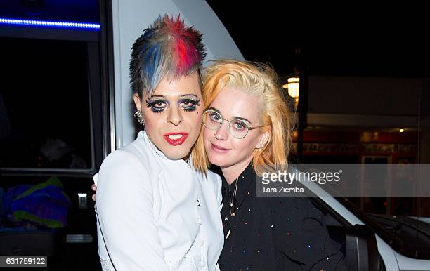 TV Personality/pop artist Sham Ibrahim and singer Katy Perry pose for a photo with a Donald Trump portrait at Oscar's on January 14 2017 in Palm...