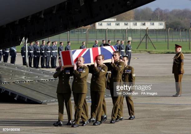 Personnel from the Royal Corps of Signals carry the coffin of Lance Corporal Steven Jones as it is returned to the UK He was one of ten servicemen...