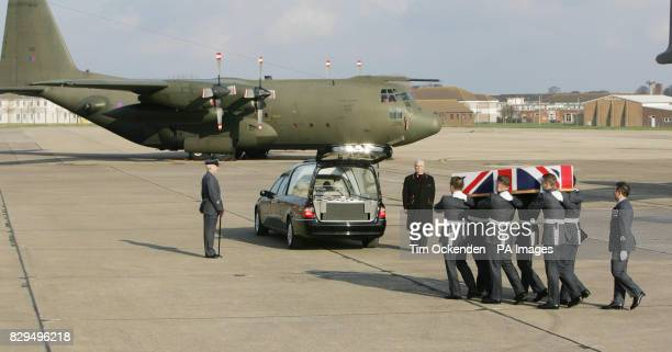 Personnel from the Royal Corps of Signals carry the coffin of Master Engineer Gary Nicholson as it is returned to the UK He was one of ten servicemen...