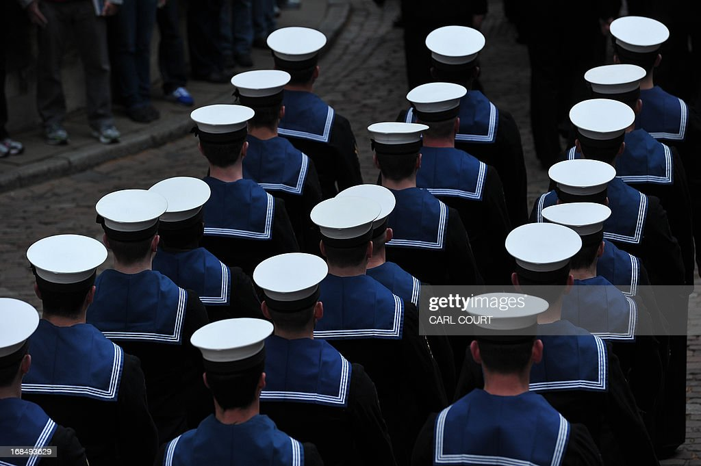 Personnel from three British Royal Navy ships, HMS Illustrious, Edinburgh and Blythe, march through the Tower of London in central London on May 10, 2013 as they deliver barrels of wine representing the dues as they take part for the first time in the historic Constable's Dues ceremony. The annual event can be traced back to the 14th century and is related to the Crown's authority over the City of London. During the Middle Ages, successive Kings believed it was their right to extract tolls from vessels on the Thames. On the King's behalf, the Constable of the Tower of London, was empowered to demand these tolls as a perquisite of his office. Past offerings have included barrels of rum, or oysters, mussels and cockles; this year, the Tower's Constable, General Lord Richard Dannatt, was presented with a barrel of wine. AFP PHOTO / CARL COURT