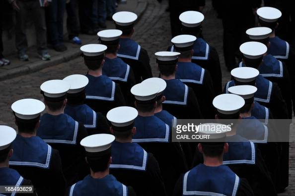 Personnel from three British Royal Navy ships HMS Illustrious Edinburgh and Blythe march through the Tower of London in central London on May 10 2013...