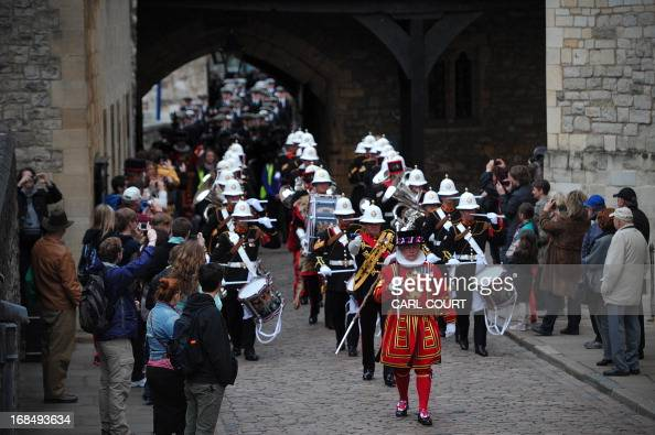 Personnel from three British Royal Navy ships HMS Illustrious Edinburgh and Blythe led by a Yeomen Warder march through the Tower of London in...