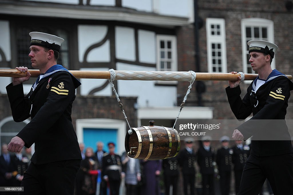 Personnel from three British Royal Navy ships, HMS Illustrious, Edinburgh and Blythe, deliver a barrel of wine representing the dues at the Tower of London in central London on May 10, 2013 as they take part for the first time in the historic ceremony of the Constable's Dues. The annual event can be traced back to the 14th century and is related to the Crown's authority over the City of London. During the Middle Ages, successive Kings believed it was their right to extract tolls from vessels on the Thames. On the King's behalf, the Constable of the Tower of London, was empowered to demand these tolls as a perquisite of his office. Past offerings have included barrels of rum, or oysters, mussels and cockles; this year, the Tower's Constable, General Lord Richard Dannatt, was presented with a barrel of wine.