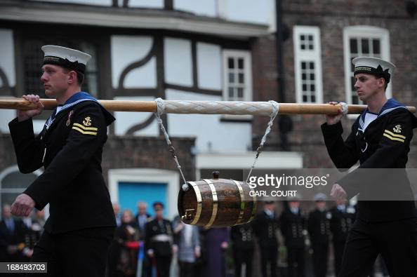 Personnel from three British Royal Navy ships HMS Illustrious Edinburgh and Blythe deliver a barrel of wine representing the dues at the Tower of...